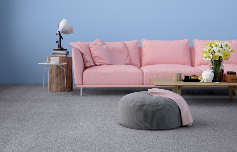 Grey carpet with pink sofa and blue walls