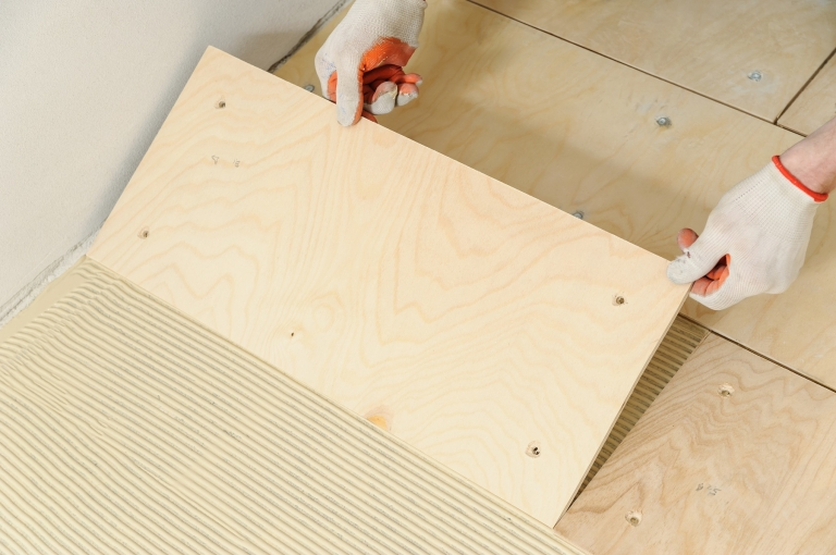 Laying down a wooden plyboard subfloor