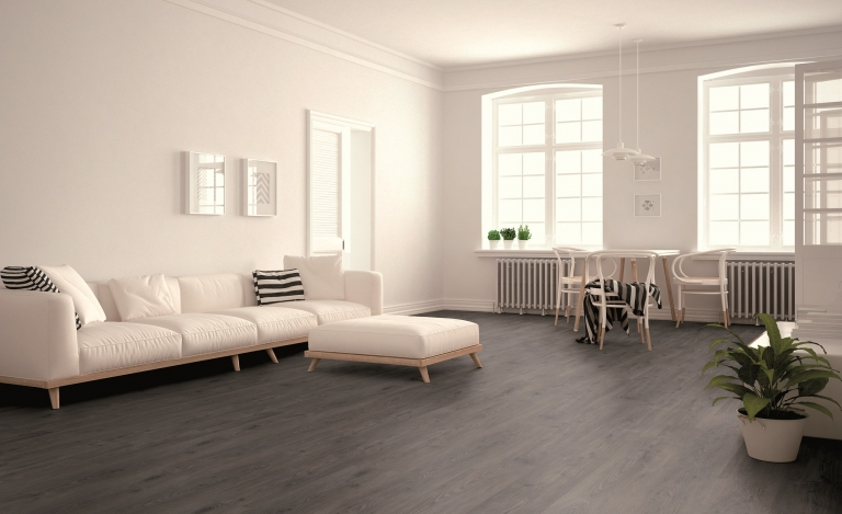 Modern grey laminate floor in open plan living and dining room